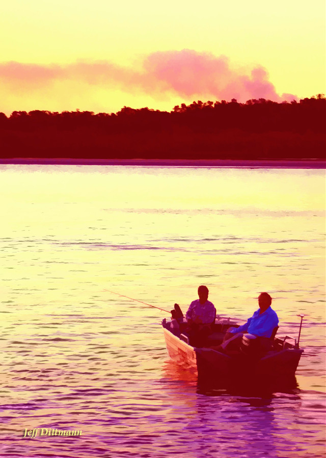 Fishing at sunset on the river at Noosa on the Sunshine Coast, Queensland Australia.